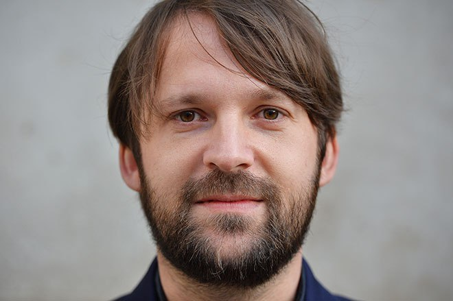 Chef Rene Redzepi of Danish restaurant Noma poses for photographers ahead of the World's 50 Best Restaurants Awards 2013 at the Guildhall in London on April 29, 2013.
