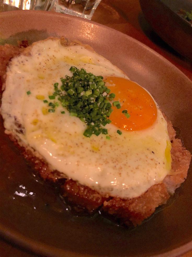 Hugo & Co - breaded pork cutlet with fried egg @Alexander Lobrano