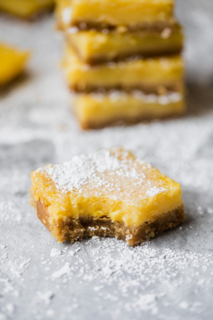 Healthy lemon bars that are gluten free, dairy free and paleo! The crust is made with a mix of almond flour and coconut flour and the light lemon filling is made with just 4 simple ingredients: fresh lemon juice, honey, eggs and coconut flour. You're going to LOVE these easy to make bars.