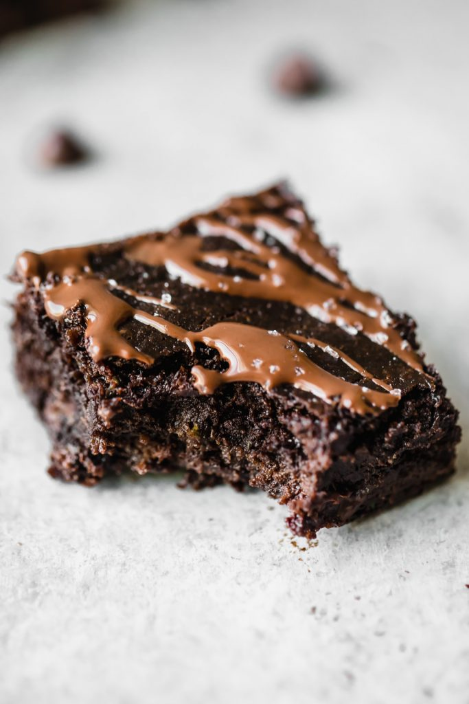 The BEST zucchini brownies you'll ever eat are healthy, gluten free, deliciously fudgy, and the perfect way to bake with zucchini. Top them with fancy sea salt to make them extra special!