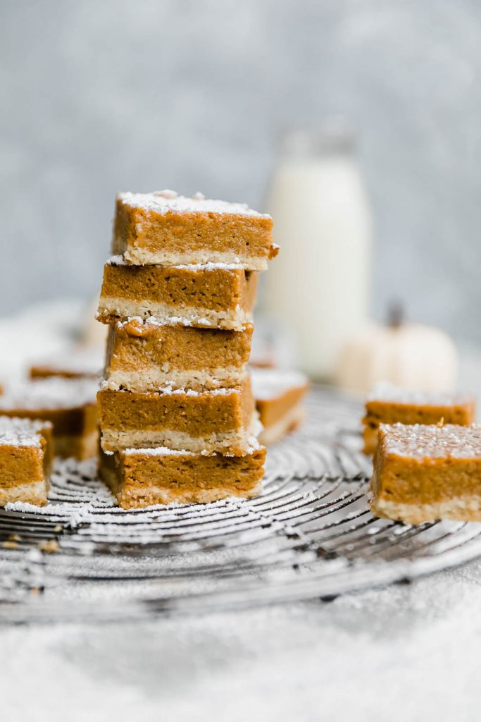 Beautiful healthy paleo pumpkin pie bars with an almond flour 'sugar cookie' crust. Easy to make and a great healthy thanksgiving dessert!