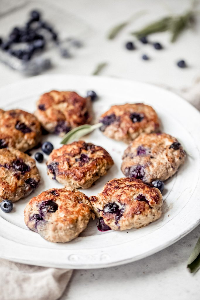 Sweet & savory paleo maple blueberry turkey sausage breakfast patties with delicious spices and juicy blueberries. Serve these incredible patties with fried eggs for the ultimate, low carb breakfast!
