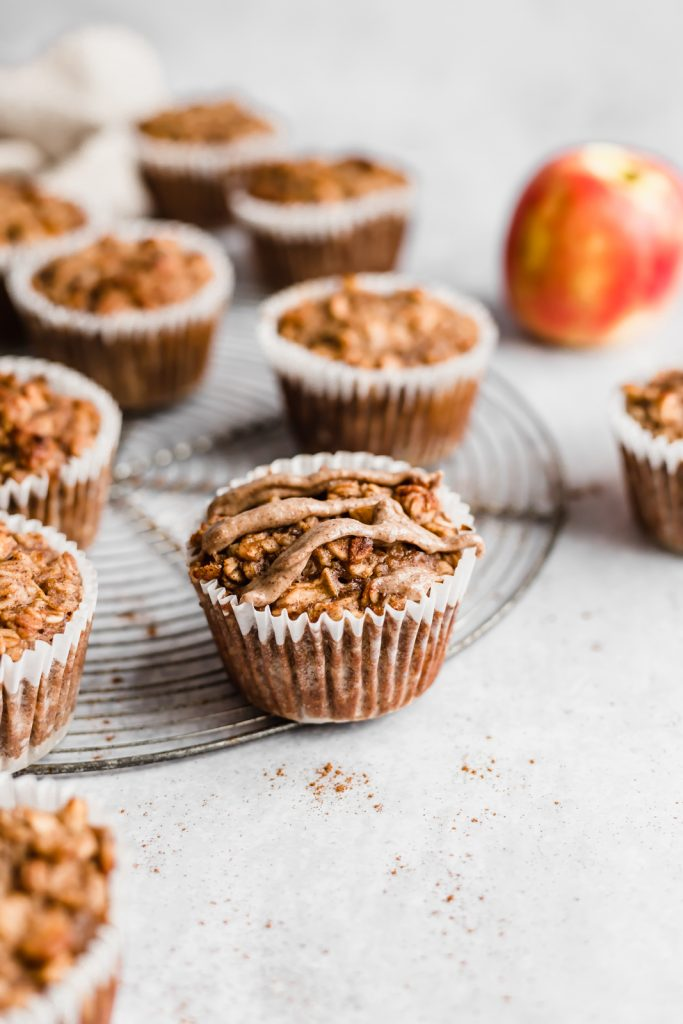 apple cinnamon baked oatmeal cups drizzled with almond butter