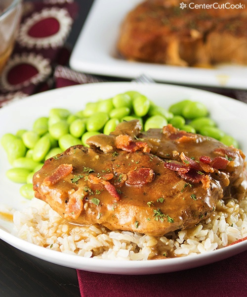 Slow cooker smothered pork chops with rice