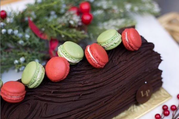 Pike Places French bakery Le Panier will offer their Bûche de Noël cakes topped with macarons in chocolate ganache and lemon buttercream this year.