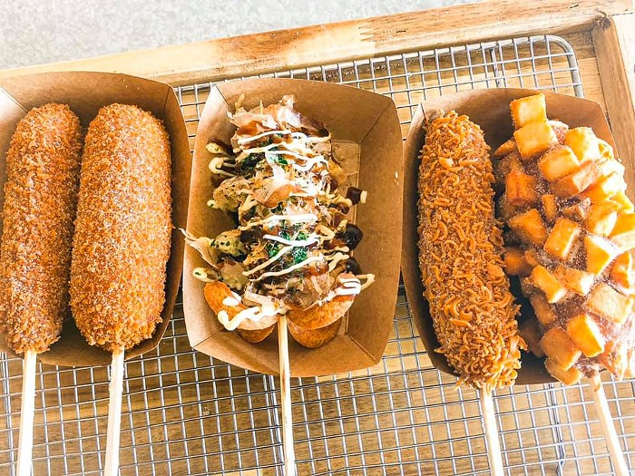A new location of the Korean street food chain Chung Chun Rice Dog, which specializes in hot dogs dipped in rice flour batter and a crunchy coating, opens today in Chinatown-International District.