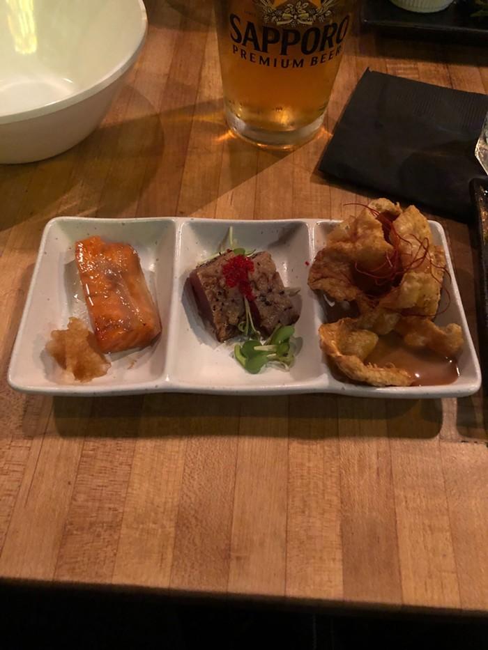 Salmon, marinated tuna, and fried chicken skin.