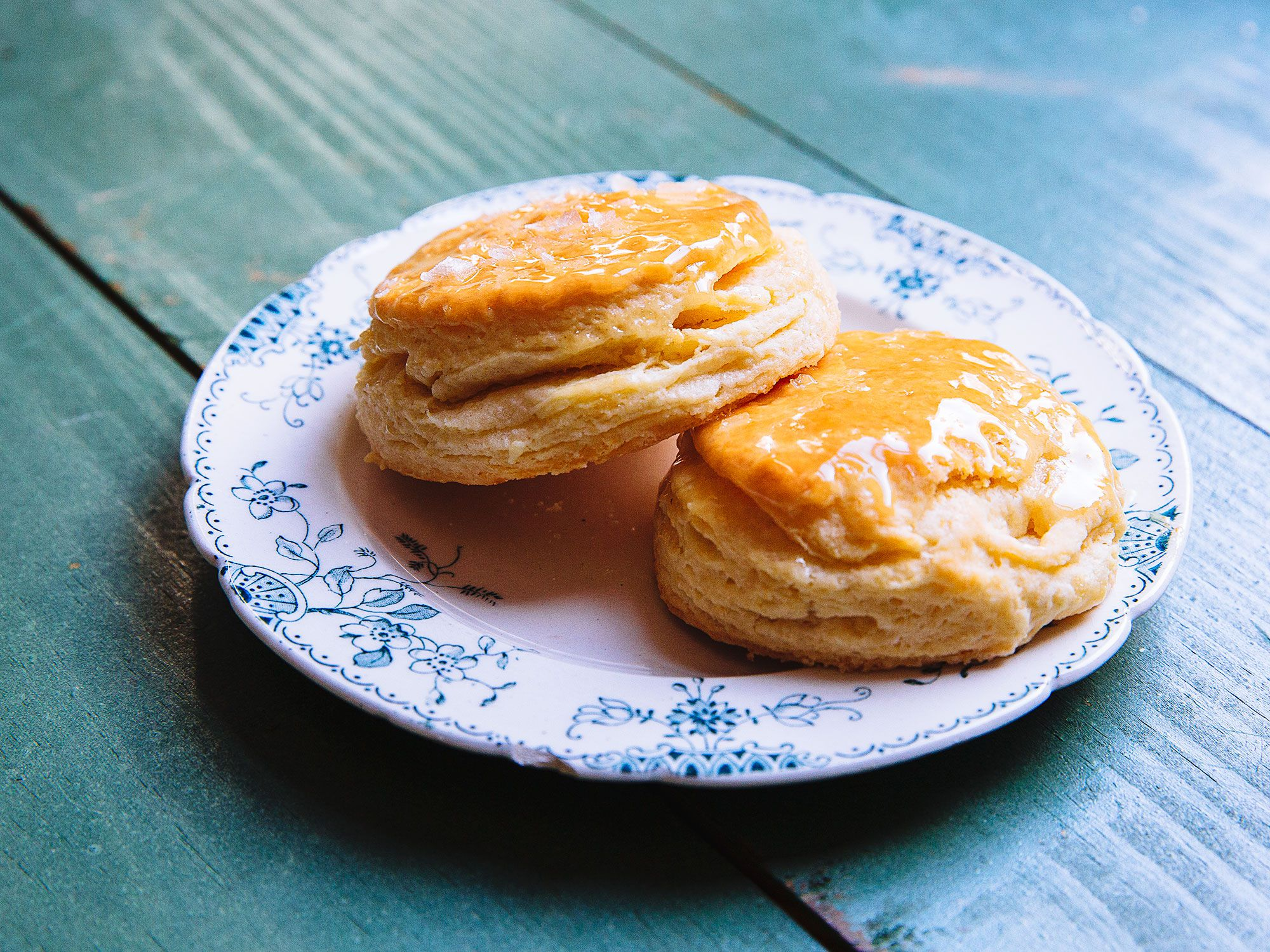 "This honey butter-topped biscuit recipe, from Jean-Paul Bourgeois, executive chef at Blue Smoke in New York City, earned first prize in the 2017 Charleston Food & Wine Festival's Battle of the Biscuits. High-quality dairy—and high-fat dairy—are two of chef Bourgeois' tricks to making them extra-special. Look for either high-fat buttermilk or a higher fat, European-style butter, which make for a more delicate, flakier texture. Get the recipe for <a href=""https://www.saveur.com/flaky-honey-butter-biscuit-recipe/"">Super-Flaky Buttermilk Biscuits With Honey Butter</a>"
