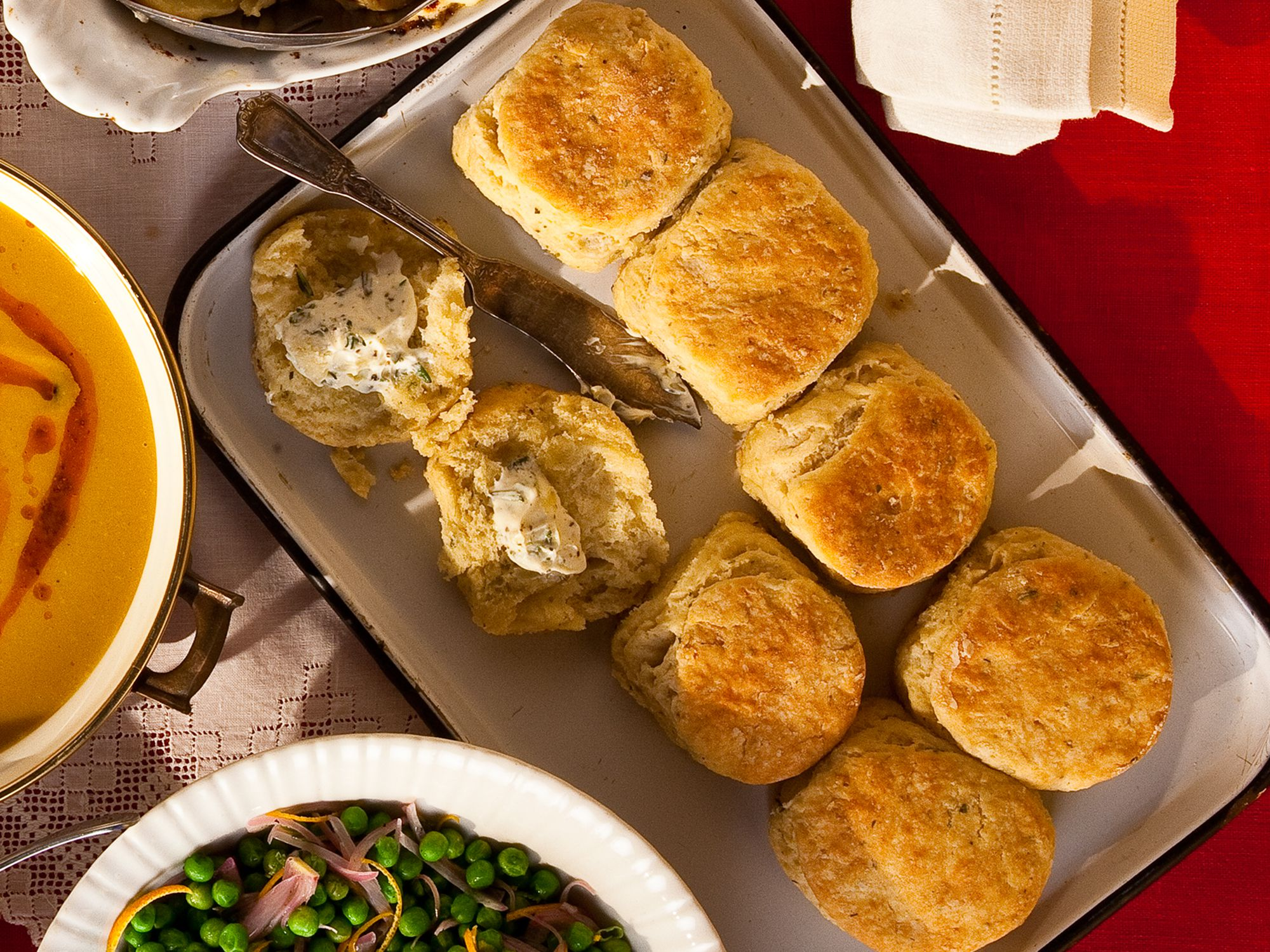 """Instead of plain dinner rolls, we like to serve these fluffy biscuits, fragrant with rosemary and thyme. Get the recipe for <a href=""""https://www.saveur.com/article/Recipes/Honey-and-Herb-Biscuits/"""">Honey and Herb Biscuits</a>"""