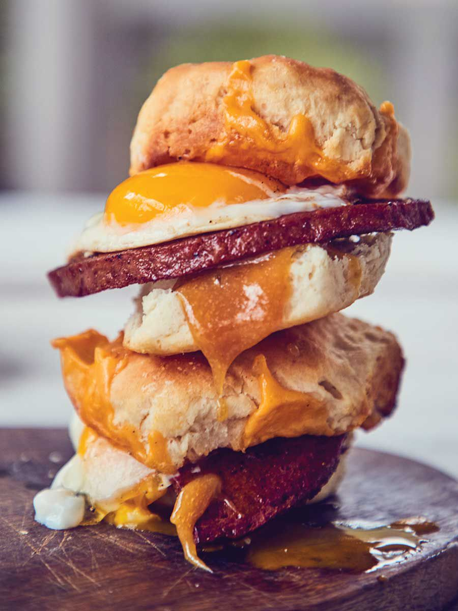 "Bologna makes an excellent breakfast sandwich swap for sausage or country ham, particularly when it's purchased from a good butcher, browned in a pan, and layered on warm, split biscuits. Runny fried eggs, melted American cheese, and sweet, sharp mustard make a good thing even better. Get the recipe for <a href=""https://www.saveur.com/bologna-egg-cheese-biscuit-recipe/"">Seared Bologna, Egg, and Cheese Biscuit Sandwiches with Sweet Mustard</a>"