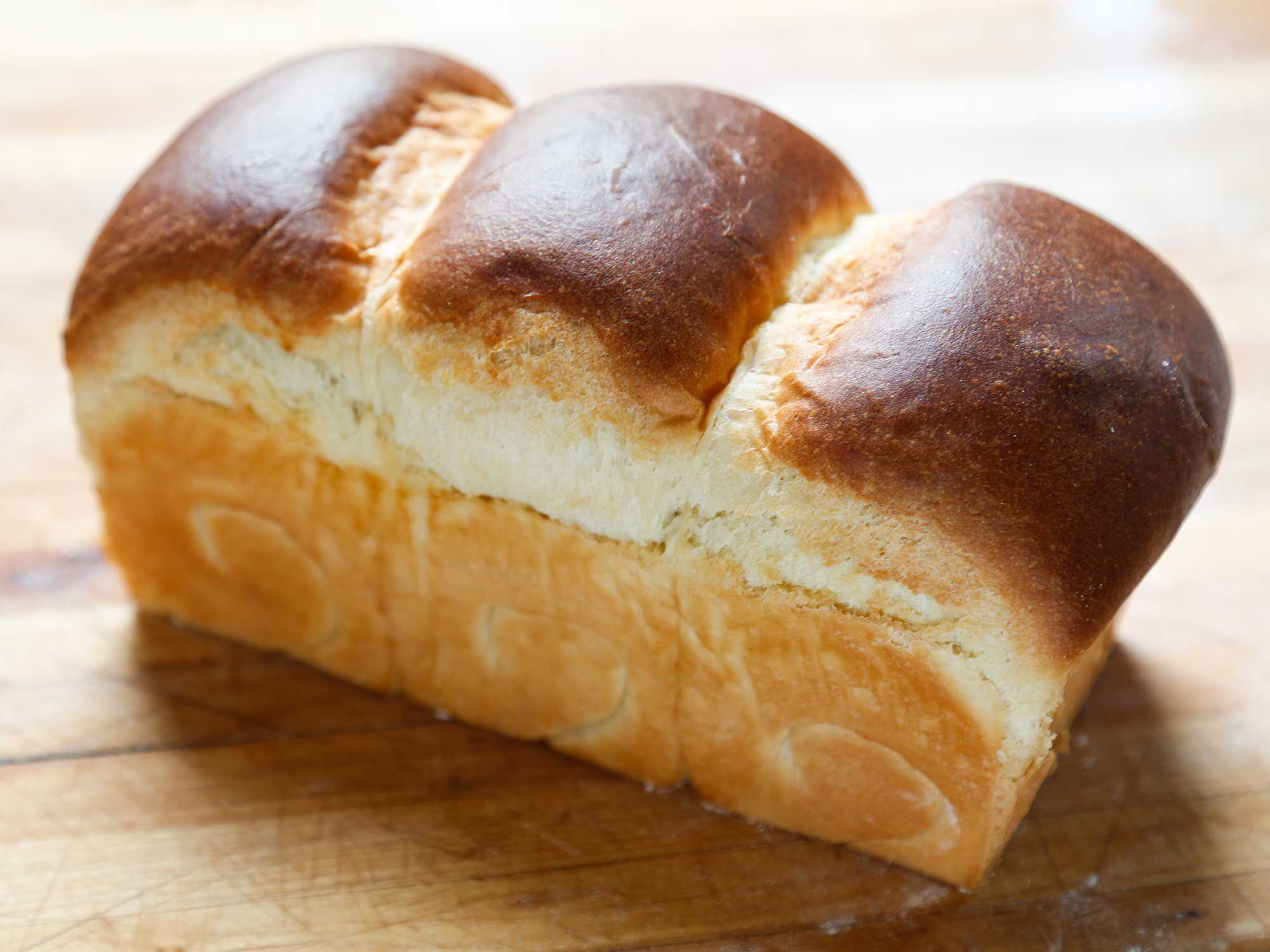 """An ethereally fluffy, generously buttery, and delightfully squishable loaf. Get the recipe for <a href=""""https://www.saveur.com/fluffy-white-bread-recipe/"""">The Fluffiest White Bread in the World</a>"""