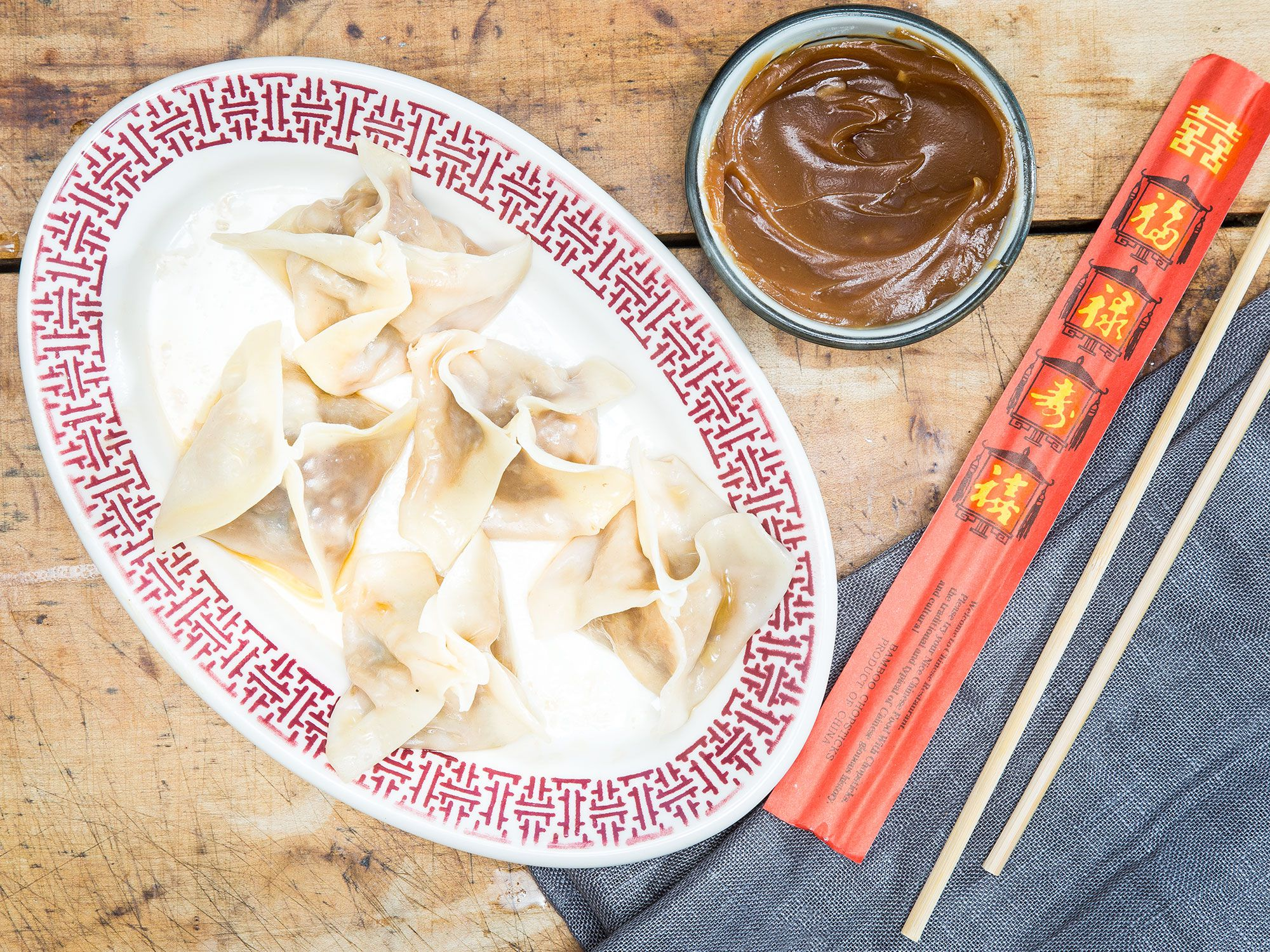 """The now-shuttered Crystal Palace of Montreal used to serve these beef dumplings as an homage to the Quebecois favorite, peanut butter dumplings. Get the recipe for <a href=""""http://www.saveur.com/montreal-peanut-butter-dumplings"""">Crystal Palace's Hunan Dumplings with Peanut Sauce</a>"""