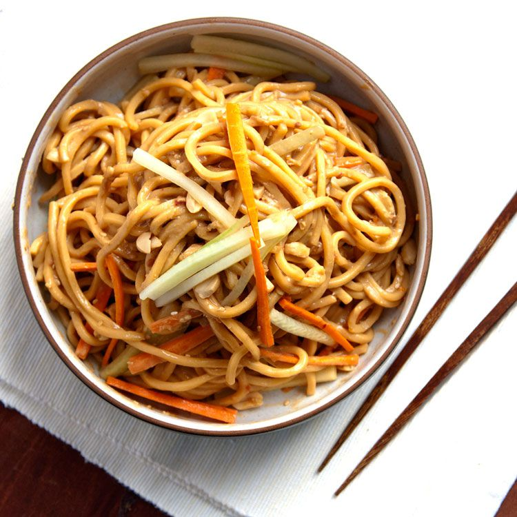 """A garnish of chopped peanuts and slivered cucumber and carrot add crunch to the silky, savory Chinese-American noodle dish. Get the recipe for <a href=""""https://www.saveur.com/article/Recipes/Classic-Sesame-Noodles/"""">Cold Sesame Noodles</a>"""