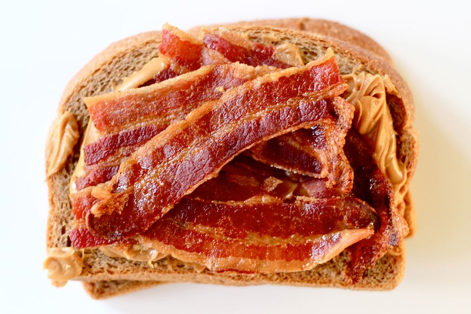 """Bring out peanut butter's savory side by topping it with a few strips of smoky bacon—cooked extra-crisp to hold up against sogginess. On hearty whole-wheat bread, it's the kind of sandwich you may not be able to wait until lunchtime to eat. Get the recipe for <a href=""""https://www.saveur.com/article/Recipes/Peanut-Butter-and-Bacon-Sandwich/"""">Peanut Butter and Bacon Sandwich</a>"""
