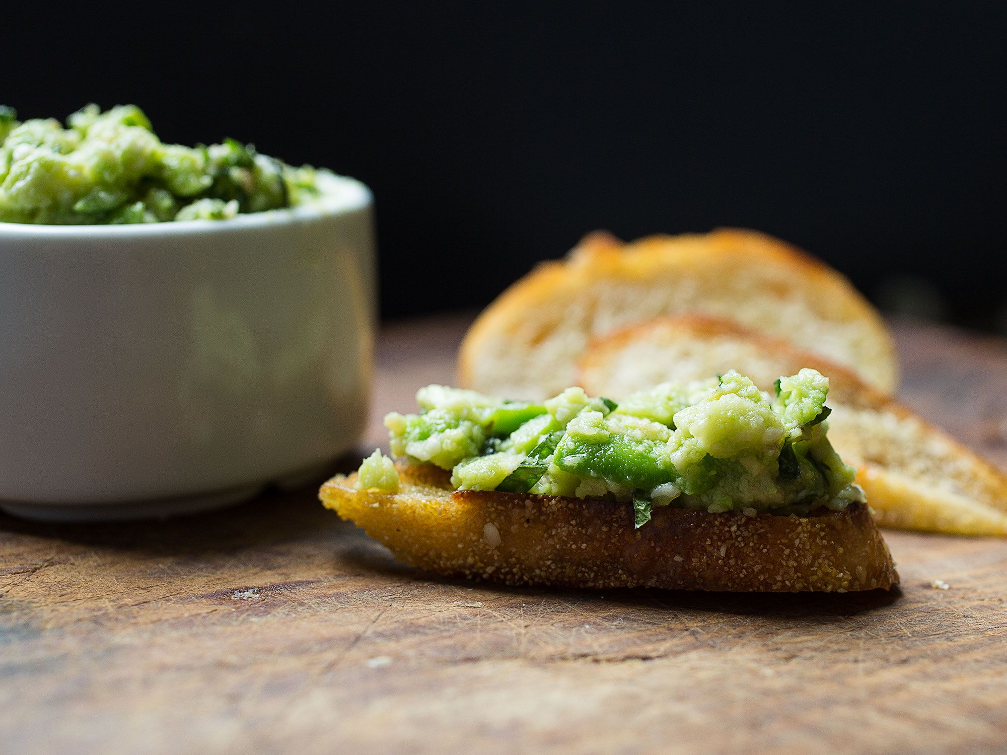 "When purchasing fresh fava beans, look for bright green pods that are free of yellow patches. Large beans are starchy and firm, while smaller ones are sweeter and more tender. If you are buying shelled beans, select beans with a smooth surface. Get the recipe for <a href=""https://www.saveur.com/fava-bean-pesto-recipe/"">Fava-Mint Pesto</a>"