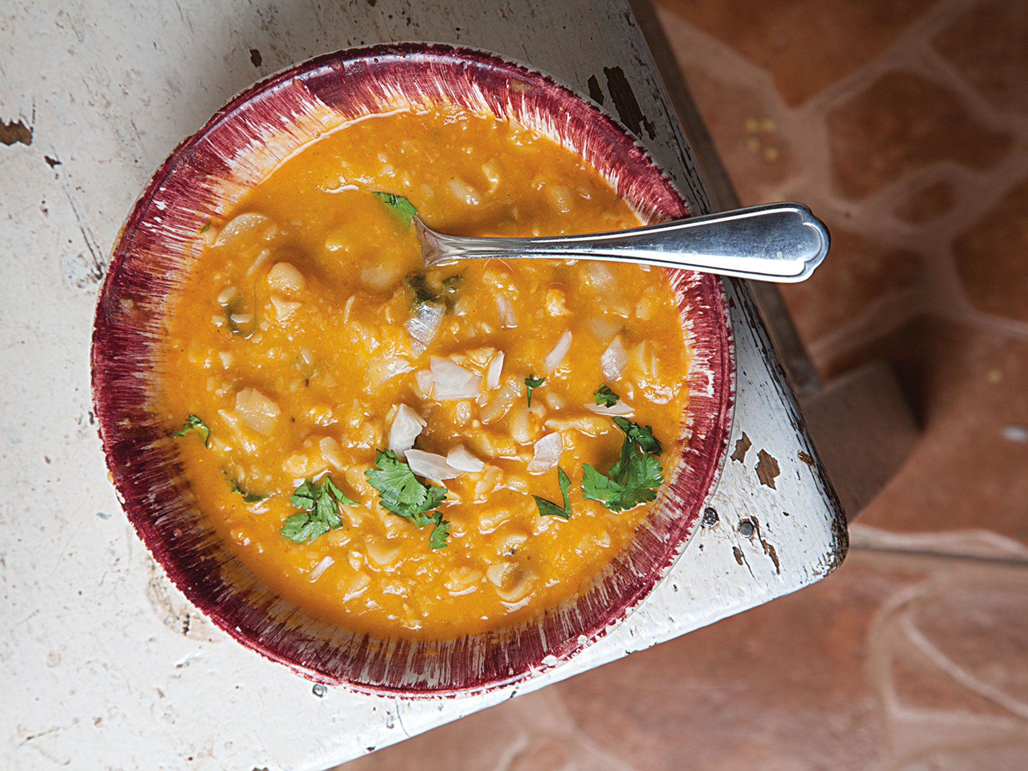 "The secret to this soup is a flavorful aromatic base of tomatoes, garlic, and onions—called a recado—that is pureed and fried before the beans go into the pot. Get the recipe for <a href=""https://www.saveur.com/article/Recipes/Sopa-de-Habas-Fava-Bean-Soup/"">Mexican Fava Bean Soup (Sopa de Habas)</a>"
