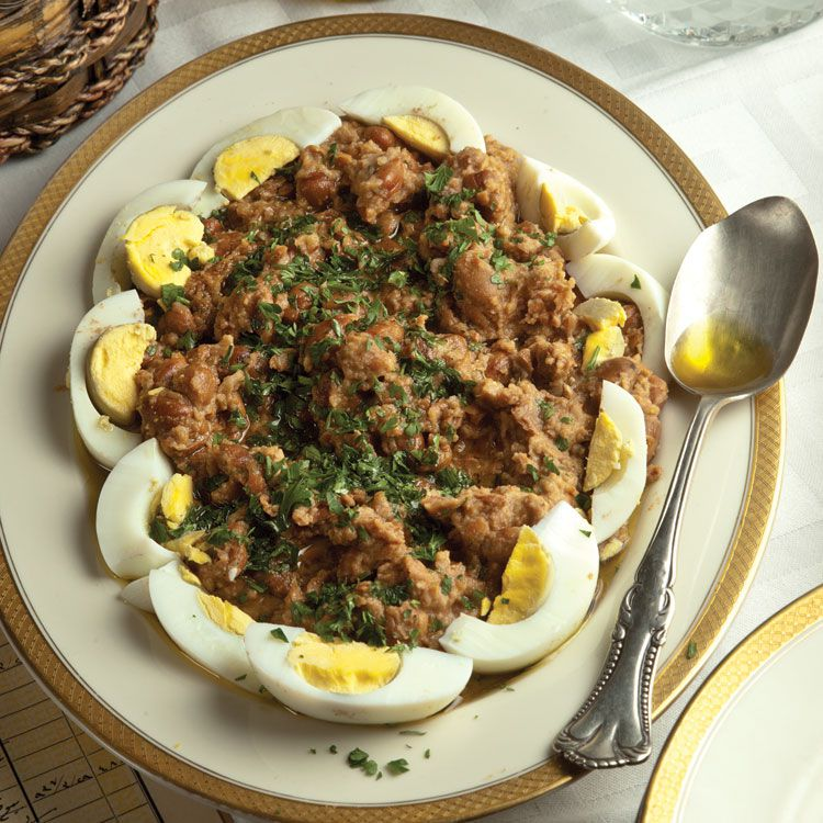 "Best known as Egypt's national dish, ful medames is a hearty stew of warmed fava beans stirred with olive oil, lemon juice, and garlic, usually eaten for breakfast. Get the recipe for <a href=""https://www.saveur.com/article/Recipes/Classic-Stewed-Fava-Beans/"">Ful Medames (Stewed Fava Beans)</a>"
