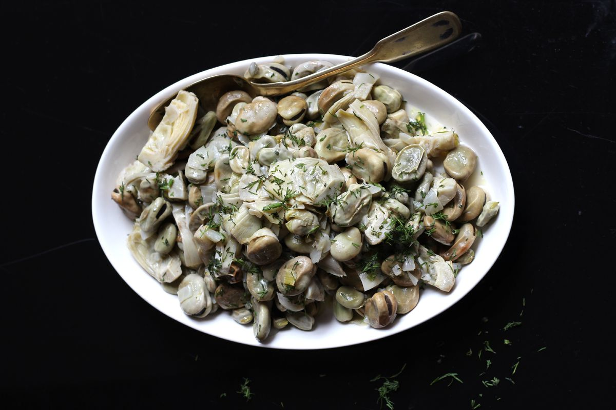 "Tender artichoke hearts and fava beans pair beautifully in this simple Greek side dish. Get the recipe for <a href=""http://www.saveur.com/article/Recipes/Aginares-Me-Koukia-Artichokes-and-Fava-Beans"">Artichokes and Fava Beans (Aginares Me Koukia)</a>"