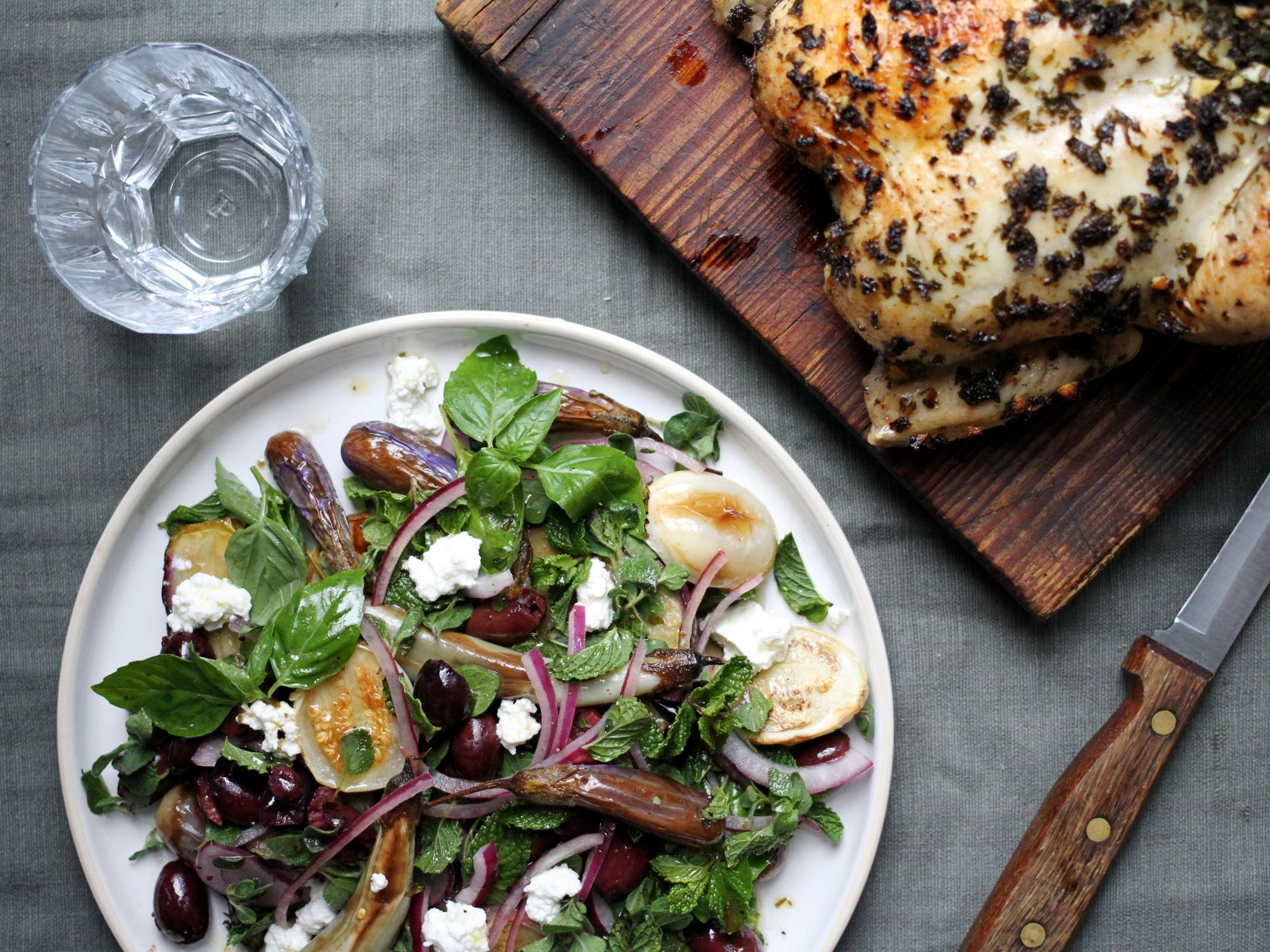 "Brighten up any day with this simple roast chicken and fresh eggplant and herb salad. Get the recipe for <a href=""https://www.saveur.com/simple-roast-chicken-eggplant-salad-recipe/"">Rainy Day Chicken with Eggplant Salad</a>"