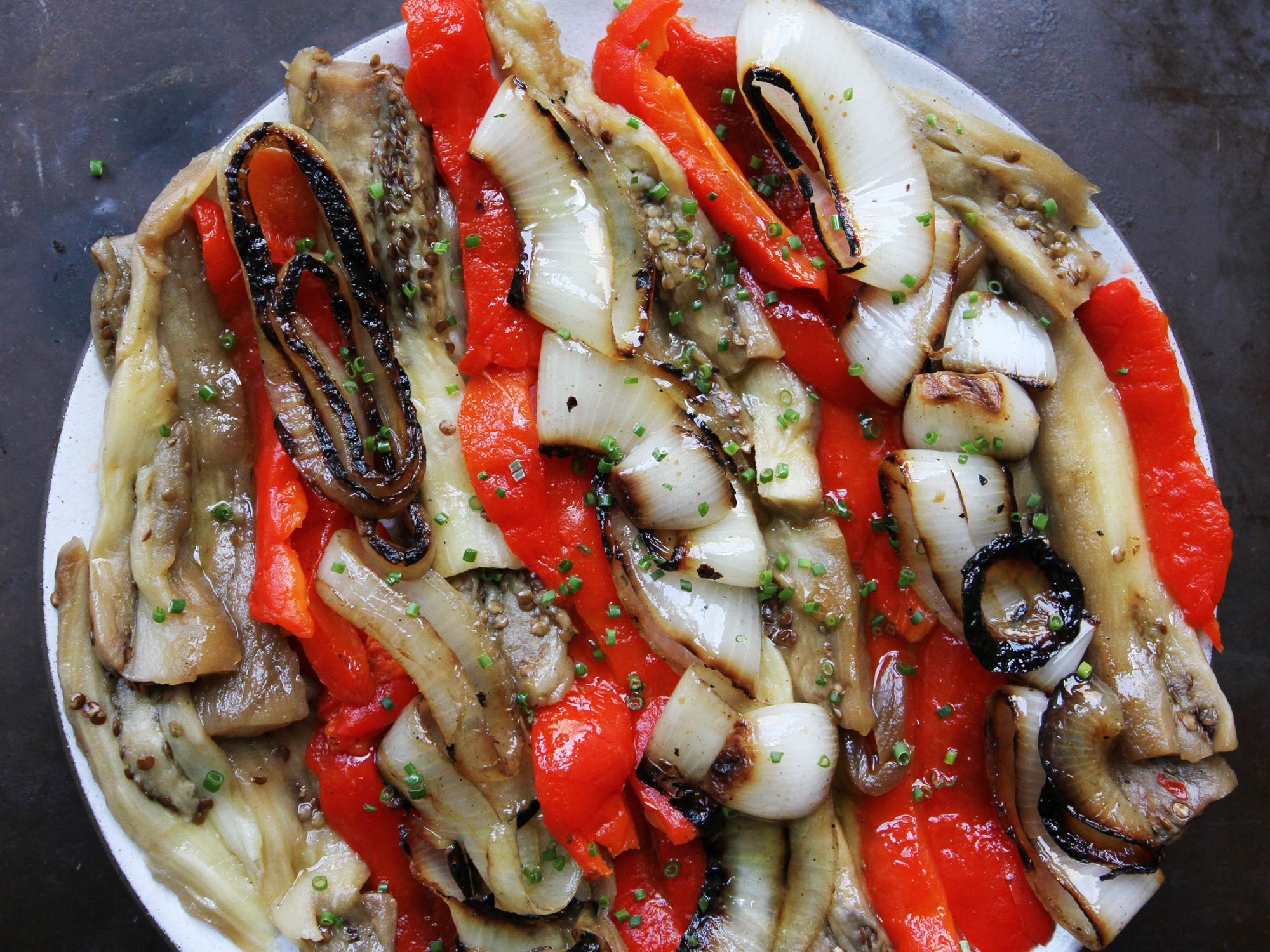 "Akin to Puerto Rican <em>escabeche</em>, roasted, tender vegetables are marinated in a simple sherry vinegar dressing for an easy side dish to grilled fish, roast pork, or tender rib eye steak. Get the recipe for <a href=""https://www.saveur.com/escalivada-catalana-recipe/"">Escalivada Catalana</a>"