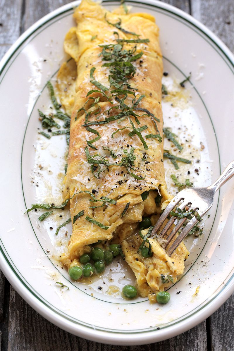 """Rich, nutty brown butter perfectly offsets the fresh flavor of sweet peas and mint. Get the recipe for <a href=""""https://www.saveur.com/article/Recipes/Brown-Butter-Peas-and-Mint-Omelette/"""">Brown Butter, Peas, and Mint Omelette</a>"""