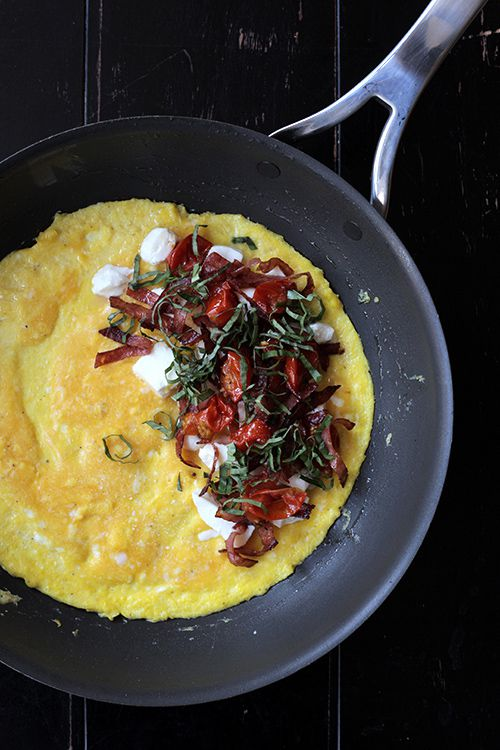 """Roasting cherry tomatoes in an oven brings out their natural sweetness; salty salami is a perfect counterpoint. Get the recipe for <a href=""""https://www.saveur.com/article/Recipes/Salami-Tomato-Mozzarella-and-Basil-Omelette/"""">Salami, Oven-Roasted Tomato, Mozzarella, and Basil Omelette</a>"""