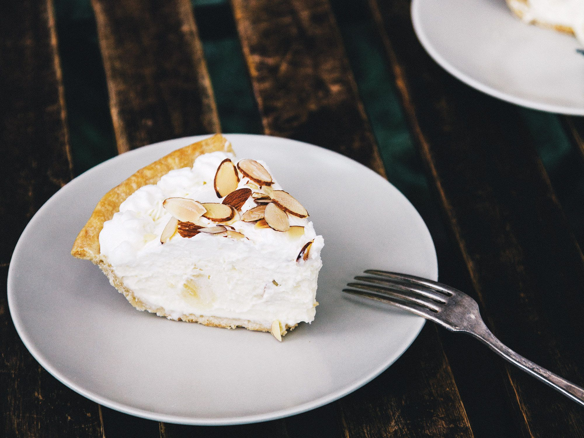 "This nearly forgotten recipe comes to us from the beloved Ships Diner in Los Angeles that closed in 1995. The whipped cream filling doesn't require any cooking—no custard here—while some slices of banana and toasted almond add texture and flavor. A fast, easy-to-make pie from a bygone era that deserves a comeback. Get the recipe for <a href=""http://www.saveur.com/easy-french-banana-cream-pie-recipe"">Classic French Banana Cream Pie</a>"