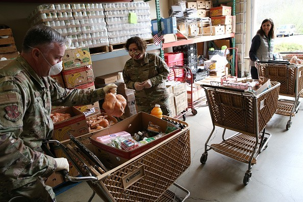 The National Guard is helping out at food banks across Washington.