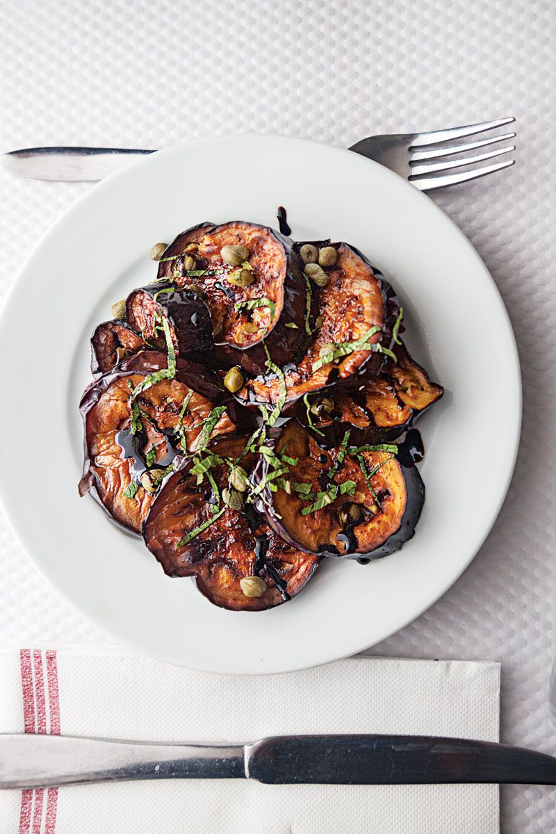 """Creamy, mild eggplant pairs with briny capers, floral basil, and a drizzle of balsamic reduction for a knockout appetizer or side dish. <a href=""""https://www.saveur.com/article/recipes/pan-fried-eggplant-with-balsamic-basil-and-capers/"""">Get the recipe for Pan-Fried Eggplant with Balsamic, Basil, and Capers »</a>"""