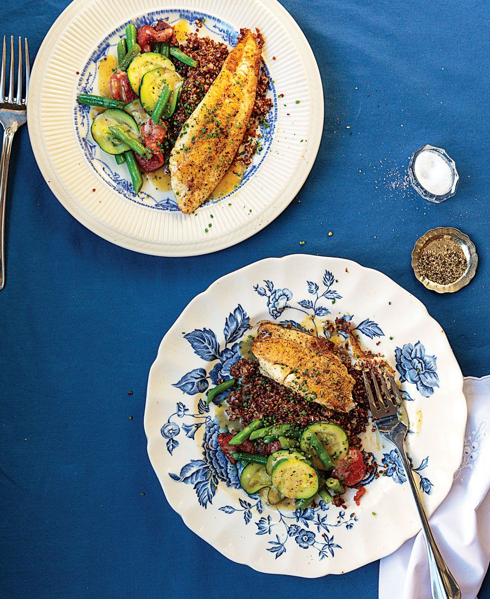 """Filets of sole are set atop red quinoa, roasted tomatoes, and tender-crisp vegetables in this dish from a Marseille bistrot. <a href=""""https://www.saveur.com/article/recipes/pan-fried-sole-with-red-quinoa-and-vegetables/"""">Get the recipe for Pan-Fried Sole with Red Quinoa and Vegetables »</a>"""