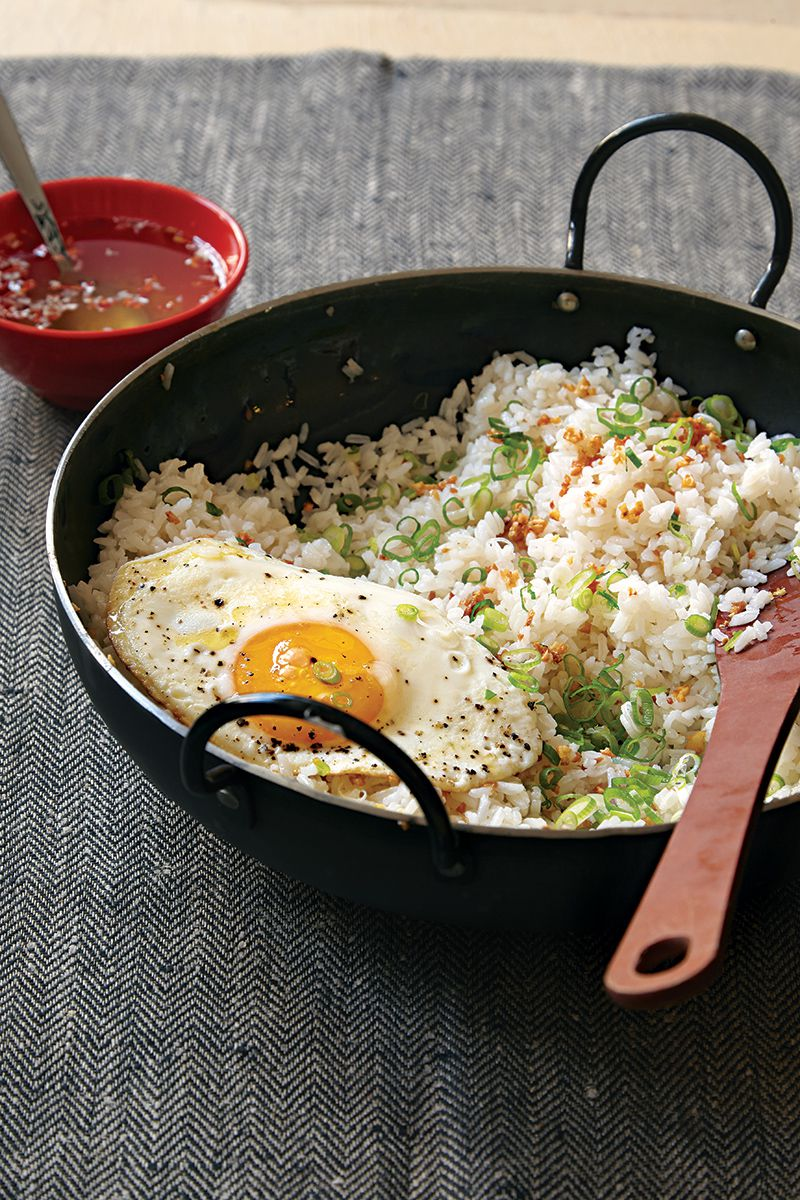 """This garlicky rice is a popular breakfast dish in the Philippines and is delicious served with fried eggs and a drizzle of vinegar sauce. <a href=""""https://www.saveur.com/article/recipes/filipino-garlic-fried-rice-with-vinegar-sauce-sinangag/"""">Get the recipe for Filipino Garlic Fried Rice with Vinegar Sauce (Sinangag) »</a>"""