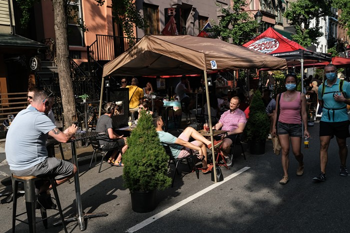 New York City started allowing street cafes on July 2. Here are people eating in the middle of the street in Manhattan on July 4.