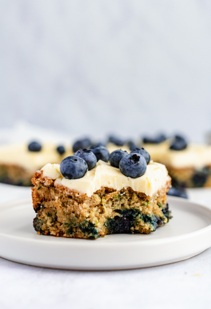 slice of healthy blueberry zucchini cake on a plate
