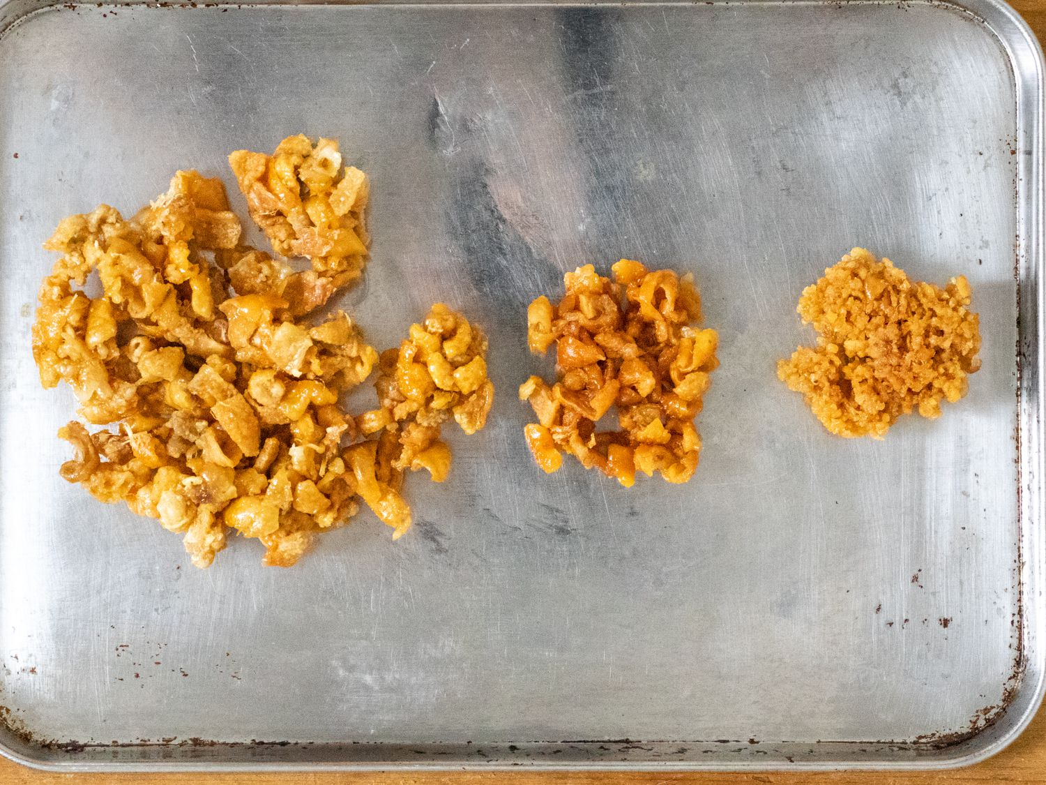 Three different chicken skin chips, produced by cutting the skin up in different ways and microwaving it.