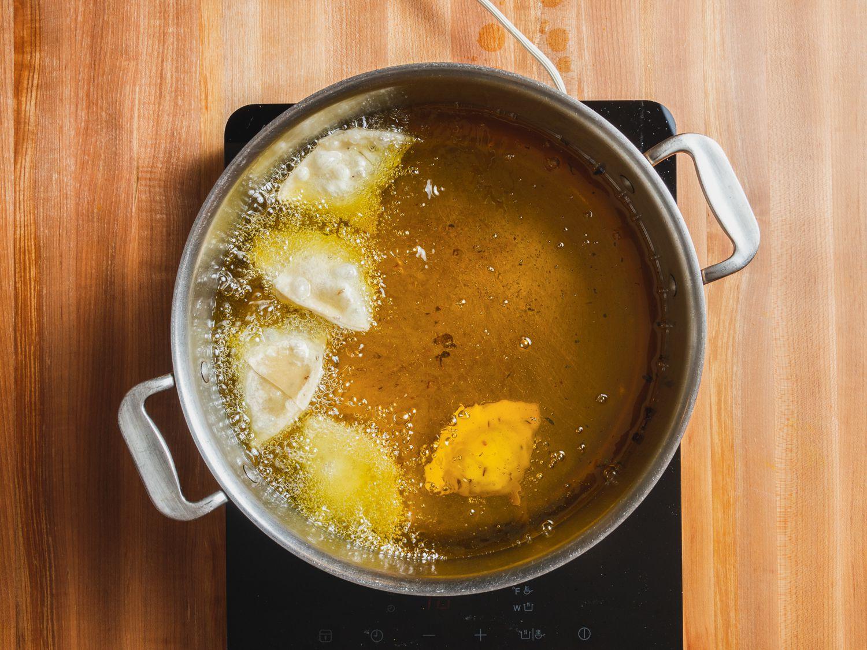 Samosa frying in oil